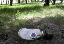 Gask mask in a wooded field
