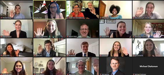Zoom screen shot of participants all smiling and waving to the camera